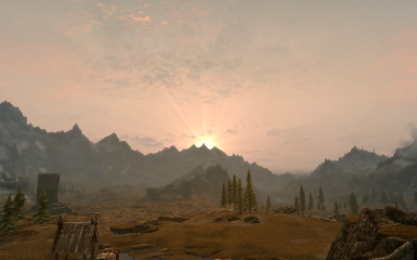 sun setting behind the mountains
