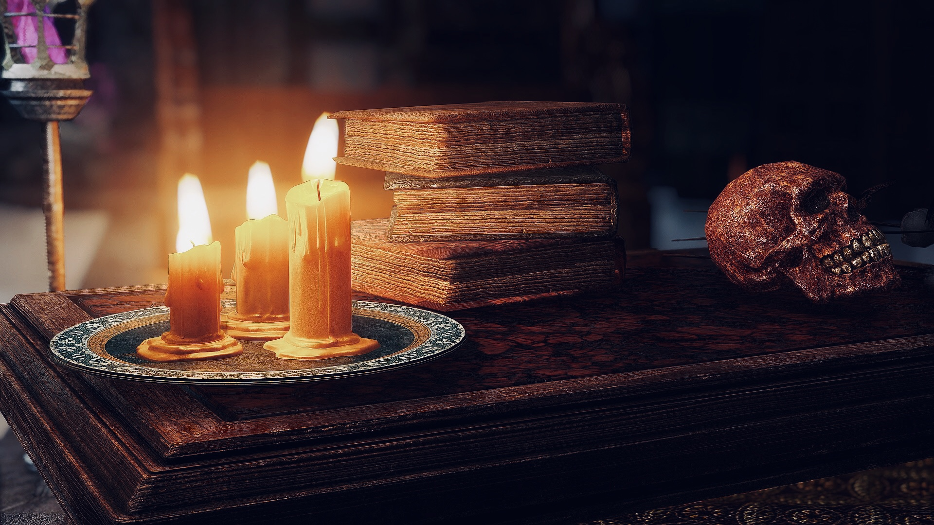 Books candles and skull