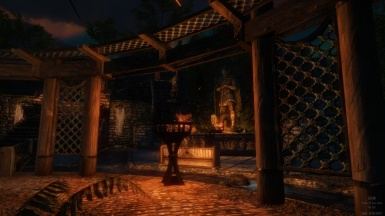 A night-time view of the Statue of Talos in Whiterun