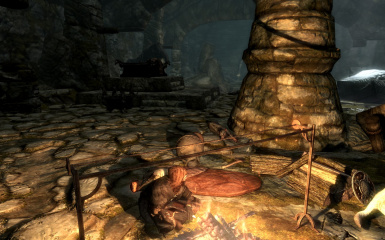 Resting by a fire before delving deeper into Bleak Falls Barrow