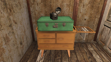 Changing table and green suitcase