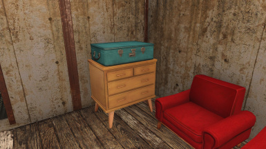 Small dresser and blue suitcase