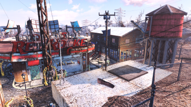 The 2 Sim Settlements plots, and behind the red rocket is a mess hall, armory, crafting facility and medic.