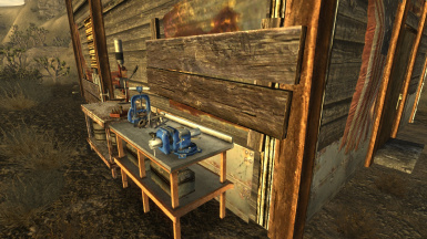 Workbenches at side of shack