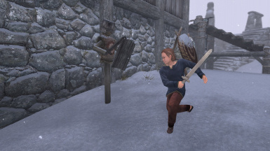 The Blacksmith's son practicing with a wooden sword
