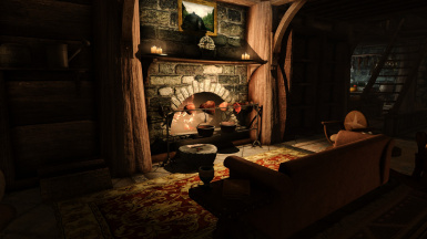 Cozy couch in front of the fireplace, perfect for cuddles