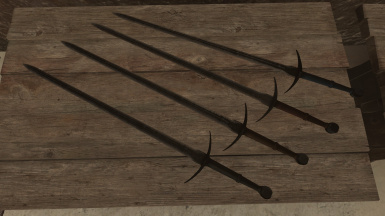 The Bastard, longer than the longsword but lighter and thinner than the claymore. It doesn't pack the same punch as the greatsword, but it moves much faster and can be wielded one-handed in a pinch. Plus its crossguard can pierce, for sweet half-swording!